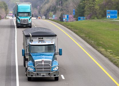 Truck drivers make their way through Bristol, Tenn., along Interstate 81 as they continue to make their deliveries despite the COVID-19 pandemic, Tuesday, April 7, 2020. Truckers across the nation are working to deliver goods. (David Crigger/Bristol Herald Courier via AP)