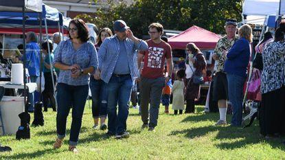 A crowd walks around Riverfest in Laurel on Sept. 30.