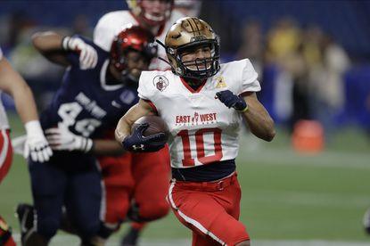 East wide receiver Malcolm Perry of Navy runs for a touchdown during the second half of the East-West Shrine Bowl on Saturday, Jan. 18, 2020, in St. Petersburg, Fla.