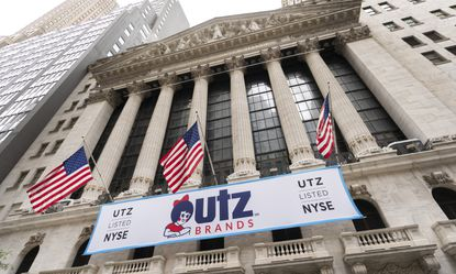 A banner for Utz Brands, which is listed at the New York Stock Exchange, hangs on the exterior of the building, Monday, Aug. 31, 2020, in New York. The Hanover, Pennsylvania, based company is known for its potato chips and snack foods. (AP Photo/Mark Lennihan)