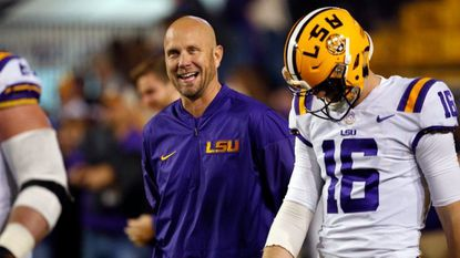LSU offensive coordinator Matt Canada walks onto the field before the Tigers played Texas A&M in Baton Rouge, La., in late November. Canada was hired by the Terps on Tuesday to serve as offensive coordinator and quarterbacks coach.