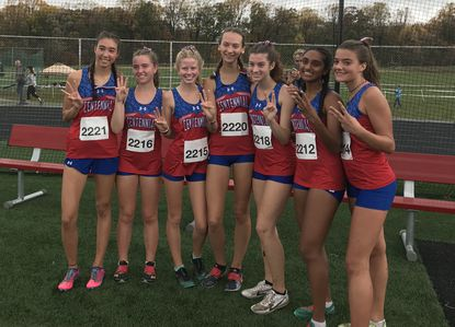 The Centennial girls cross country team poses for a picture after it won the MPSSAA Class 3A East region meet for the third straight year on Thursday, Oct. 31, at Centennial High School.