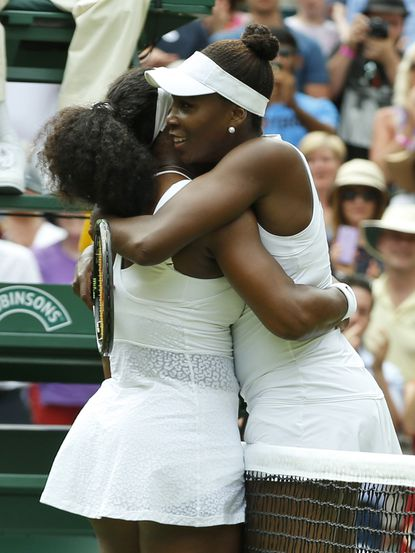 Serena Williams, left, hugs her sister Venus Williams after winning their singles match, at the All England Lawn Tennis Championships in Wimbledon, London, Monday July 6, 2015.The Williams sisters meet again, in the U.S. Open, on Tuesday, Sept. 8.