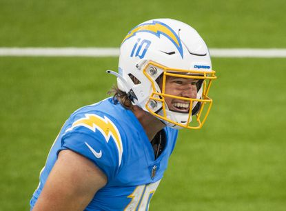 Quarterback Justin Herbert surprised many with an outstanding rookie season after taking over for the injured Tyrod Taylor. After hiring Rams defensive coordinator Brandon Staley as coach, putting together a solid draft and getting star safety Derwin James back from a season-ending injury, the Chargers are once again offseason darlings. According to Vegas sportsbooks, the Chargers' over/under win total is 9, and they have 30-to-1 odds to win the Super Bowl.