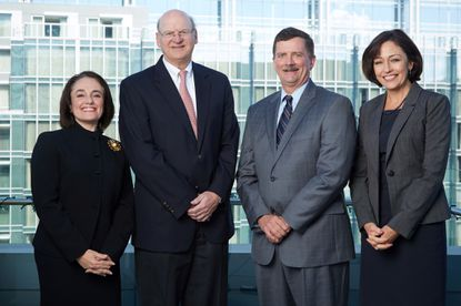 The longtime Baltimore law firm of Ober|Kaler has agreed to a merger with Baker Donelson, a major firm with offices throughout the southeast. Pictured are Jennifer P. Keller, president & chief operating officer of Baker Donelson; Ben C. Adams, chair & CEO of Baker Donelson; S. Craig Holden, chair & CEO of Ober|Kaler; and Darlene R. Davis, president & chief operating officer of Ober|Kaler.