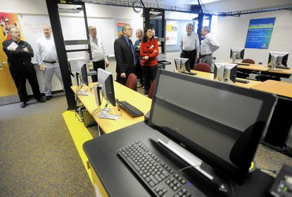 Visitors view the cybersecurity lab at Carroll Community College in Westminster during the lab's grand opening Thursday, Feb. 11.