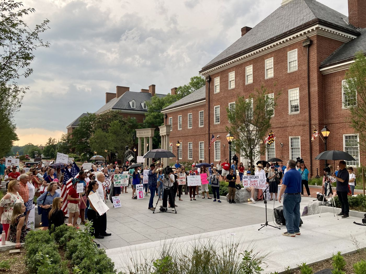 More than 200 people opposed to the COVID-19 vaccine mandate of the University of Maryland system cheer the speakers at a rally organized by the Love Maryland pac at Lawyers Mall in Annapolis.