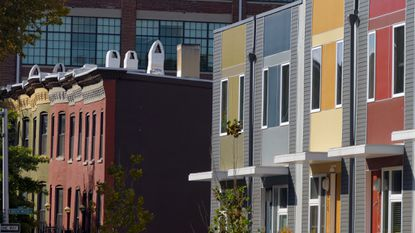 Baltimore, MD -- New homes contrast with the old row houses west of them, in a view near the City Arts building at 440 East Oliver Street.