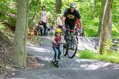Travis Pastrana, seen here with his wife Lyn-Z riding bikes and skateboards on a pump track with one of their daughters, has pulled the plug on his plans to develop a state-of-the-art racing facility and motorsports park in the Eastern Shore town of Sudlersville.