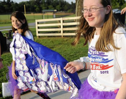 Emily Magoon, right, and Cassie Myers, with Girls Scout Troop 1861 from Ellicott City, parade around the course during the 2012 Relay For Life of Western Howard County at Western Regional Park.