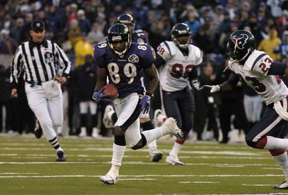 Mark Clayton makes a catch before he is knocked out of bounds against the Houston Texans in 2005. The play set up the game-winning field goal for the Ravens.