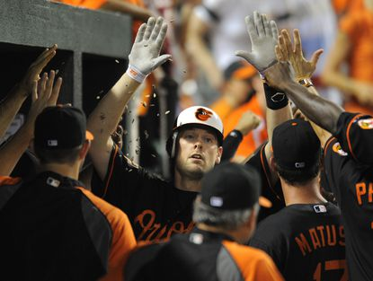 Matt Wieters is congratulated by teammates in the Orioles dugout after hitting a three-run homer in the sixth inning against the Indians.