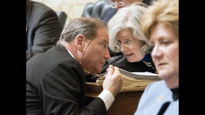 Harford County Delegate Rick Impalleria whispers with Harford County Delegate Susan McComas at the opening of the General Assembly.