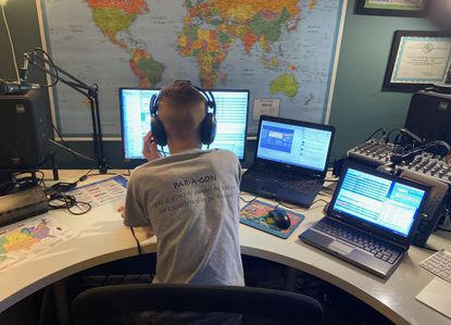 Ben Stewart, 12, makes contacts at his computer from home this year as part of the Laurel Amateur Radio Club.