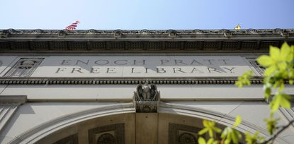 """The front entrance to the Enoch Pratt Free library's central branch. The year's most popular book at Enoch Pratt libraries so far is """"There, There"""" by Tommy Orange."""