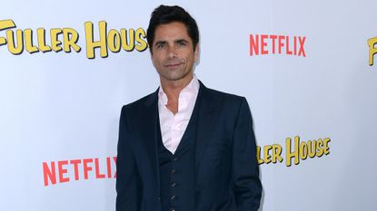 John Stamos is dating a mystery woman, reads scathing 'Fuller House' reviews
