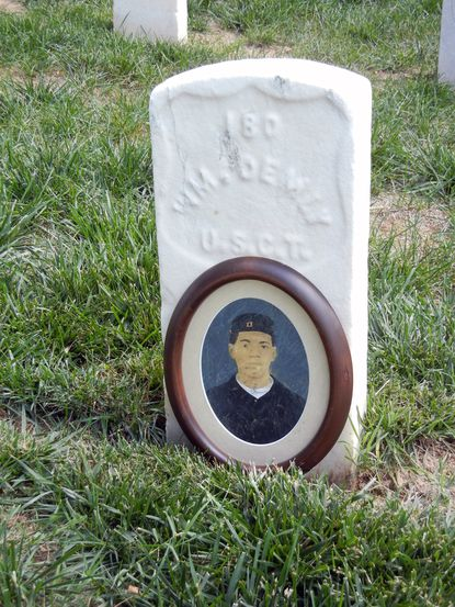 Photo of William Demby's gravestone in Loudon Park National Cemetery with his photo from the collection of Ross Kelbaugh.