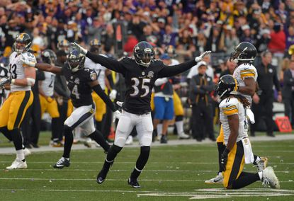 Baltimore Ravens cornerback Shareece Wright (35) reacts after Pittsburgh Steelers wide receiver Markus Wheaton (11) drops a pass on fourth down, returning the ball to Baltimore with less than two minutes remaining during the fourth quarter in Baltimore. The Ravens held on to thwart the Steelers, 20-17 on an afternoon of NFL upsets.