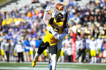 Towson receiver Caleb Smith hauls in a pass in the Tigers' game against Delaware on Saturday at Johnny Unitas Stadium.