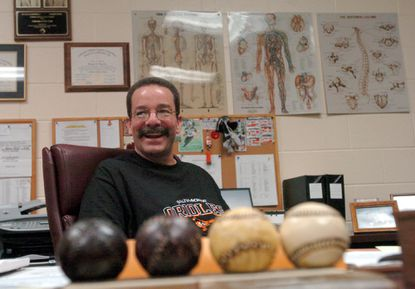 Richie Bancells, the head athletic trainer for the Orioles is pictured in his office at Camden Yards in 2004.