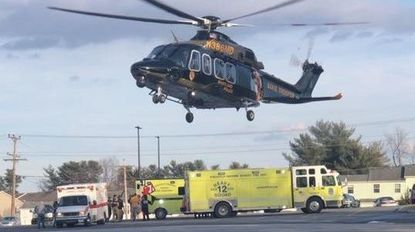 Two patients were believed to be in stable condition following a collision between a motorcycle and a vehicle near Carrolltowne Elementary School on Tuesday, Feb. 5.