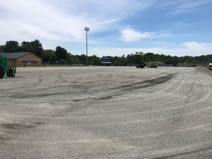 The old original turf is gone and the new turf is due in the week of June 29.
