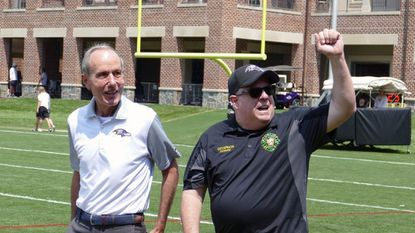 Maryland Gov. Larry Hogan, right, along with Ravens President Dick Cass, left, at the Under Armour Performance Center.