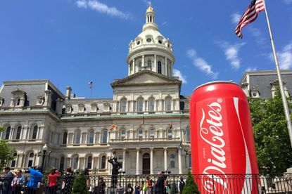 "A large inflatable soda can with the word ""diabetes"" was placed in front of City Hall prior to a hearing on a bill that would require city businesses to post warnings about the consumption of sugar-sweetened beverages."