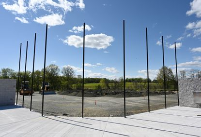 The backstop poles are in place along with foul poles and outfield fencing as the Miracle League of Harford County field at the Schucks Road Regional Park in Bel Air is nearing completion.
