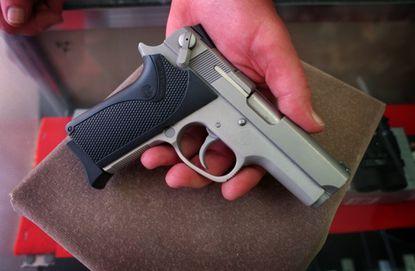 The handgun board that couldn't shoot straight