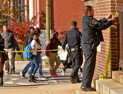 A police officer puts up crime tape after the stabbing of a 17-year old male student at Renaissance High School. The victim, a junior, is in critical condition and the attacker, a 17-year old sophomore, was taken into custody. at Renaissance High School.