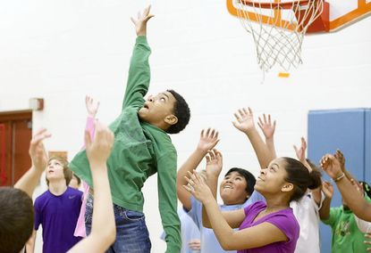 Students reach to catch a ball at Elkridge Elementary's final Hop-Shoot-Jump-a-Thon fundraiser Feb. 16. During its 11-year-run, the event raised about $100,000 to fight cystic fibrosis.