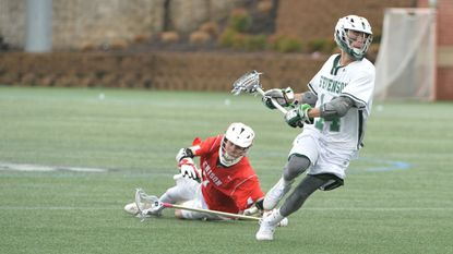 The Stevenson men's lacrosse team's decision to move Ethan Christensen (white jersey) from the midfield to the attack paid huge dividends as the sophomore led the offense in assists and ranked second in points.