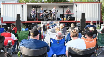 People listen as the band Half Serious performs on stage during the carnival at the Harney Volunteer Fire Company on June 25. Half Serious is scheduled to play at the Stables at Westminster on Saturday at 9 p.m.