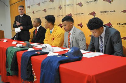 From left, Christian Brother John Kane, Coach Donald Davis '96, Lawrence Cager, Bryan Marine and Kenji Bahar attend a signing event on Feb. 4. Cager, Marine and Bahar as well as Dionte Austin, not pictured, have signed to play football in college.