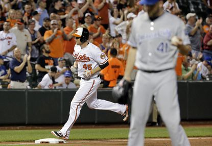 Baltimore Orioles' Mark Trumbo, back, rounds the bases after hitting a solo home run off of Kansas City Royals starting pitcher Danny Duffy (41) in the seventh inning of a baseball game in Baltimore, Monday, June 6, 2016. Baltimore won 4-1. (AP Photo/Patrick Semansky)