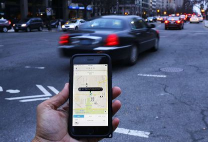 An UBER application is shown as cars drive.