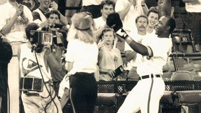 Orioles first baseman Randy Milligan entertains fans at a game in June 1991 at Memorial Stadium.