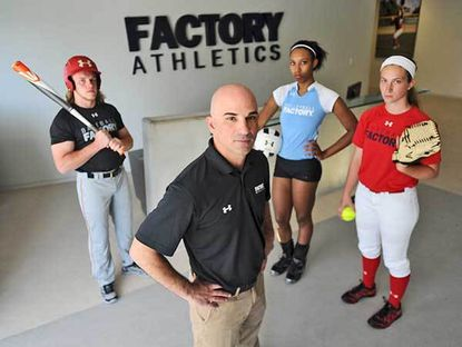 Baseball player Cuinn Mullins, a rising senior at Wilde Lake High School; Steve Sclafani, chief executive officer of Factory Athletics; volleyball player Ravyn Richardson, a 2014 Mount Hebron High School graduate; and softball player Jordan Cargile, a 2014 Eastern Technical High School graduate.