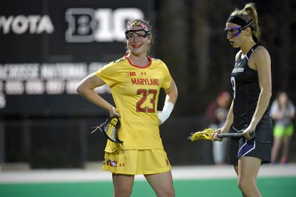 Maryland attack Megan Whittle (23) smiles while Northwestern defender Jasmine Docal stands with her, awaiting the faceoff after the Terps scored their fifth goal during the first half in College Park. The No. 1 Terps won, 17-4, over the No. 14 Wildcats.
