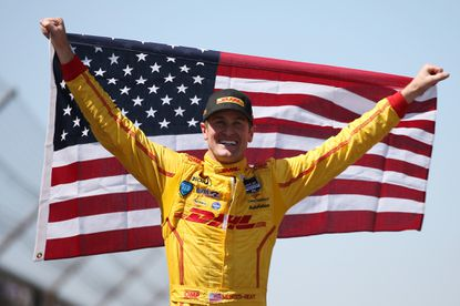 A red flag helped Ryan Hunter-Reay win the Indy 500 on Sunday. He celebrated afterward with a different flag.