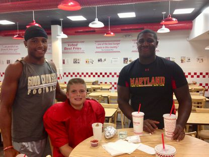 "Keandre Jones, then a freshman at Good Counsel, has dinner with his ""brother,"" Nick Vance, and former Terp Adam McLean."