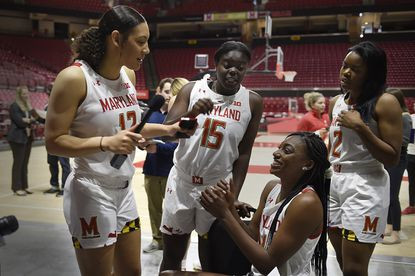 Maryland NCAA college women's basketball players, left to right, Mimi Collins, Ashley Owusu, Diamond Miller and Zoe Young question each other during Media Day, Oct. 17, 2019 in College Park, MD. (AP Photo/Gail Burton)
