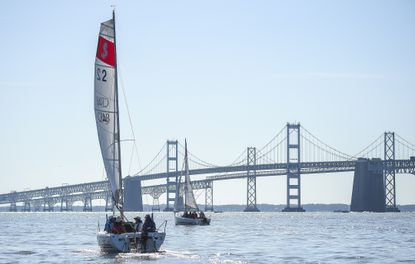 Sailboats like these operating near the Chesapeake Bay Bridge should be allowed to operate during the coronavirus pandemic, a local marina owner says.