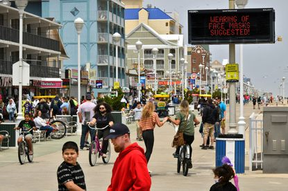 Moderate crowds returned to Ocean City this weekend after Gov. Hogan lifted the Stay-At-Home order. Signs encourage visitors to wear masks and maintain social distance. May 17, 2020