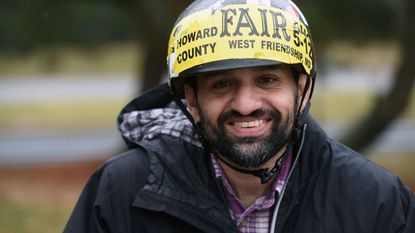 """Athar Khan, known as the """"Columbia Bike Guy,"""" has been riding his bike along Broken Land Parkway every day since 2001 as a way to manage severe depression and obsessive compulsive disorder."""