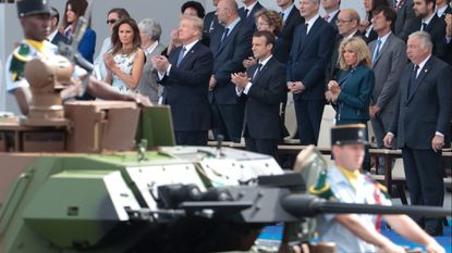 France's top leaders and President Donald Trump and First Lady Melania Trump attend the annual Bastille Day military parade on the Champs-Elysees in Paris last summer.
