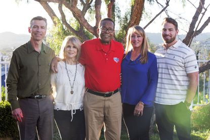 In this March 2, 2017, photo provided by the American Heart Association, posing from left are Ralf Reuland, Rhonda Carew, Rod Carew, Mary Reuland and the Reulands' son Austin at the Reuland home in San Juan Capistrano, Calif. Konrad Reuland, brother of Austin, was a former NFL football player who died of a brain aneurism at the age of 29 in December 2016. Reuland's heart and a kidney were anonymously transplanted into Rod Carew.