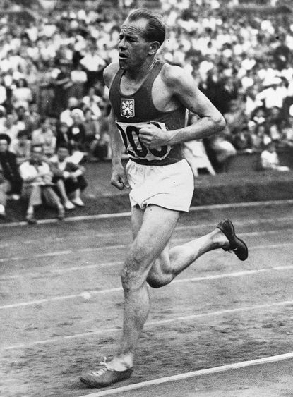 Czechoslovakia's Emil Zatopek wins the men's 10,000-metre Olympic Games race at Wembley Stadium, London, July 30, 1948. Zatopek set a new Olympic record for the race. (AP Photo)