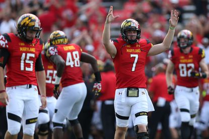 Terps quarterbackCaleb Rowe (7) and teammates celebrate a touchdown in the fourth quarter against the Richmond Spiders at Byrd Stadium on Sept. 5, 2015 in College Park.